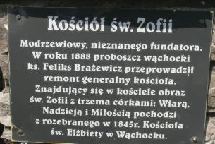 Tablica informacyjna znajdująca się przed wejściem do kościoła pw. św. Zofii w Ratajach